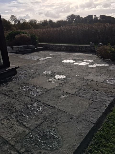 Cut stone paving and Seating areas at Menlo Galway